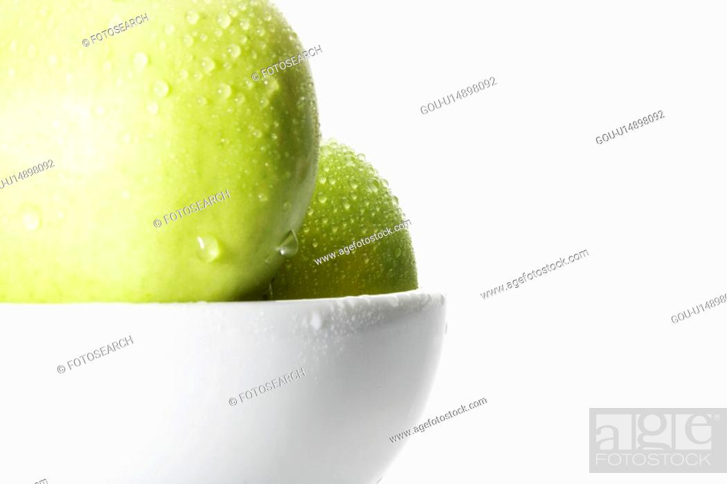 Stock Photo: Water droplets on green apples (close-up).