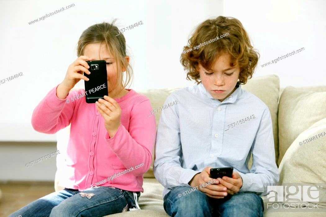 Stock Photo: Children using smartphones.