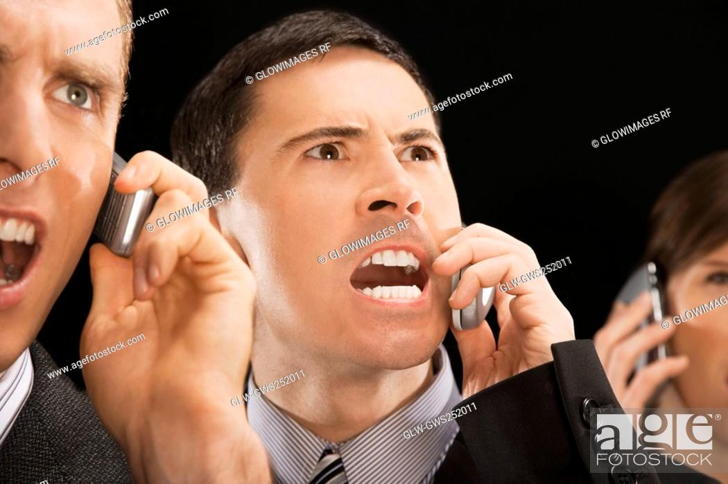 Stock Photo: Close-up of business executives shouting on mobile phones.