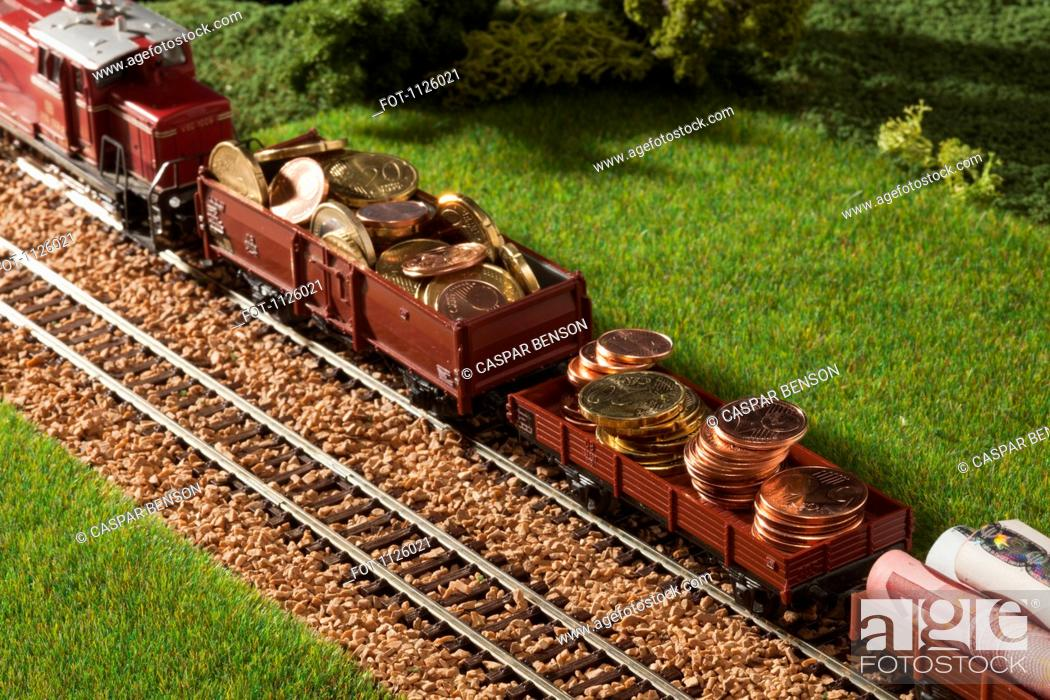 Stock Photo: A diorama of a miniature train carrying European Union currency.