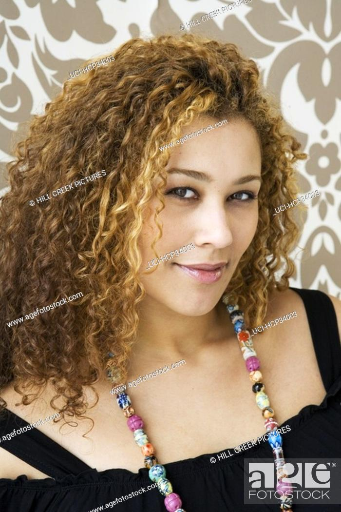Stock Photo: Close-up of woman wearing multicolored necklace.
