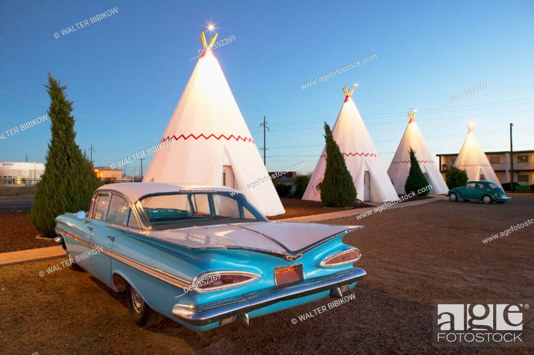 Stock Photo: Wigwam motel concrete teepees and 1959 Chevrolet on Route 66 at evening. Holbrook. Arizona, USA.
