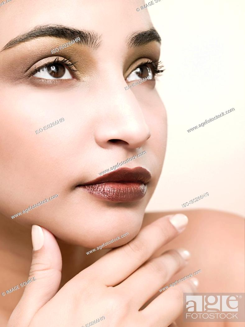 Stock Photo: A young woman thinking.