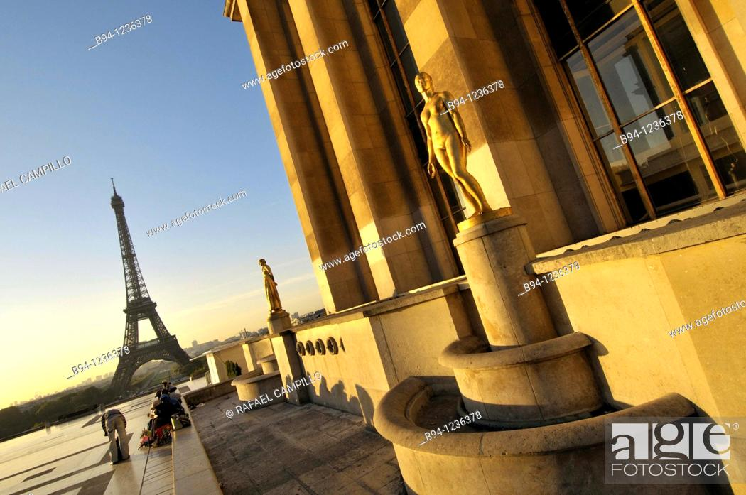 Stock Photo: Eiffel Tower from the Terrace the Rights of Man of Chaillot Palace. Gilded statue, the Youth, 1937, by Alexandre Descatoire, in the background, and the Morning.