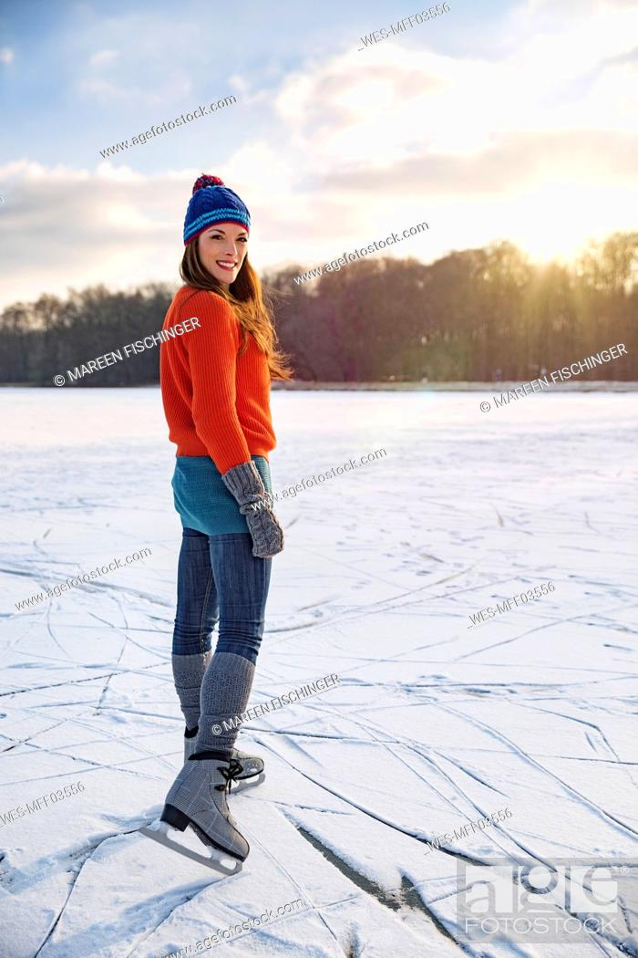 Stock Photo: Portrait of woman ice skating on frozen lake.