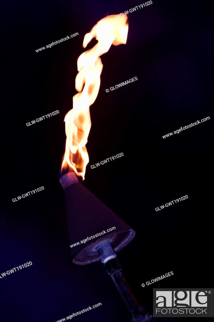 Stock Photo: Close-up of a burning flaming torch.
