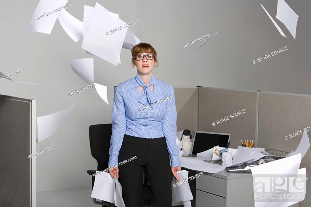 Stock Photo: Businesswoman throwing paper into the air.