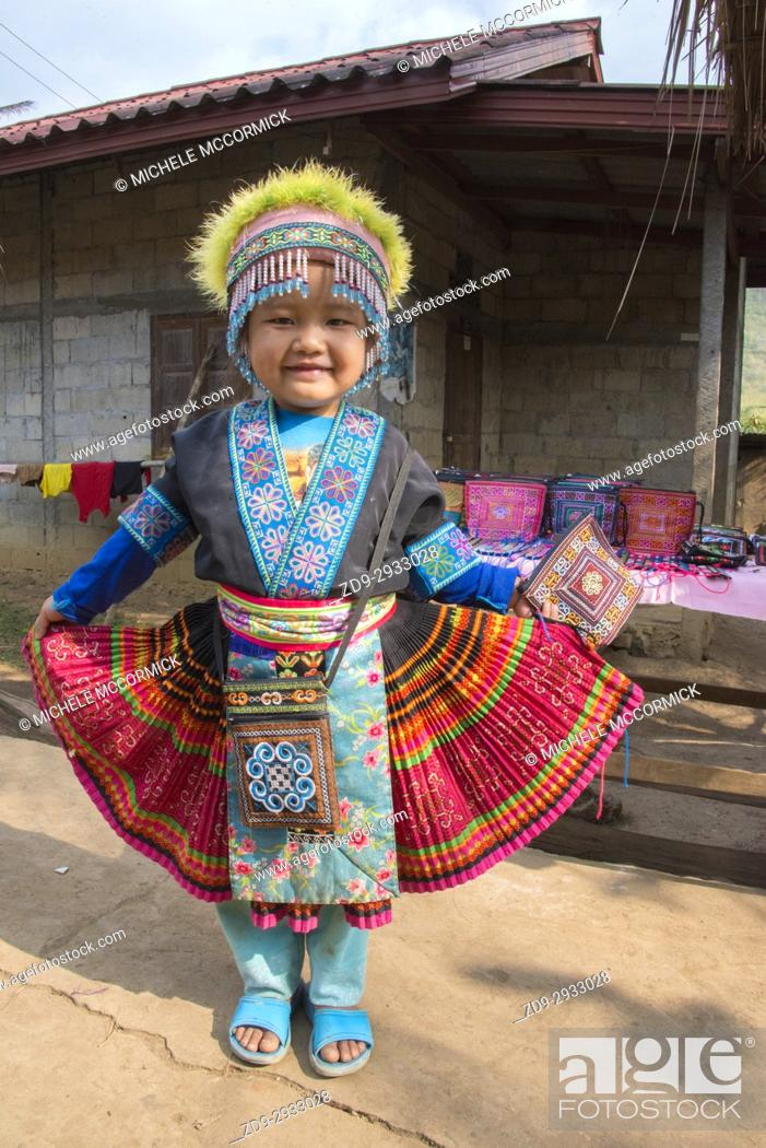 Stock Photo: A young girl in traditional Hmong dress in Laos near the Mekong River. 3/16.
