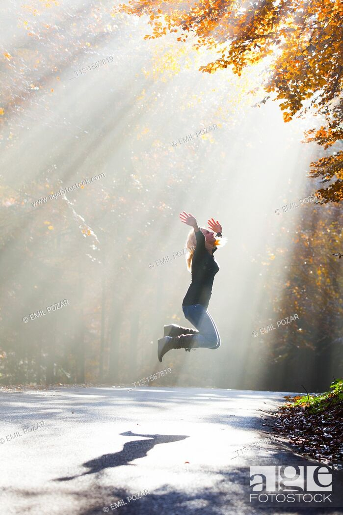Stock Photo: Young woman happy in Autumn.