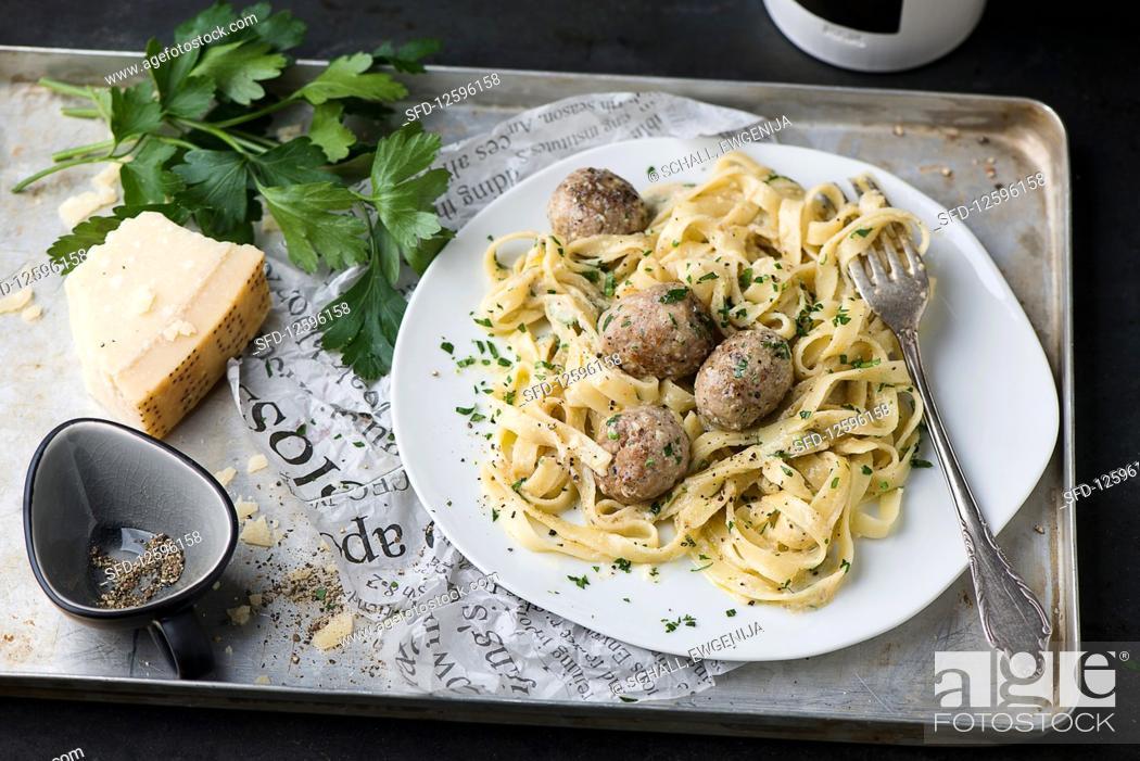 Stock Photo: Pasta carbonara with meatballs.