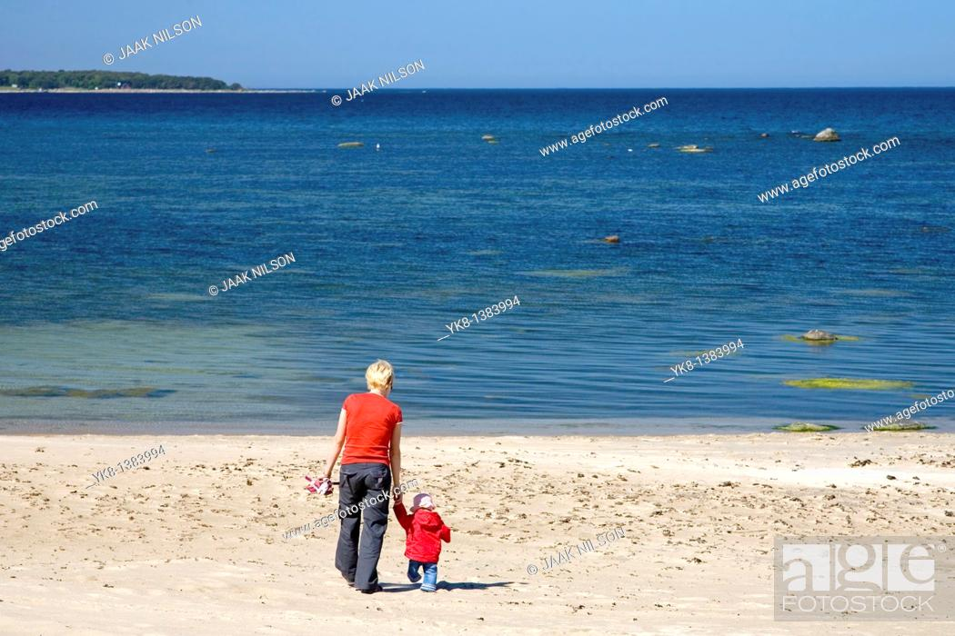 Stock Photo: Mother and Daughter Walking Away Hand in Hand on Vääna-Jõesuu Beach by Baltic Sea, Estonia, Europe.