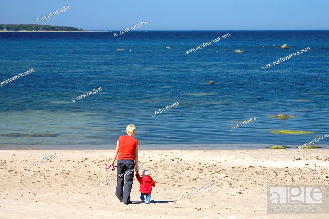 Stock Photo: Mother and Daughter Walking Away Hand in Hand on Vääna-Jõesuu Beach by Baltic Sea, Estonia, Europe.