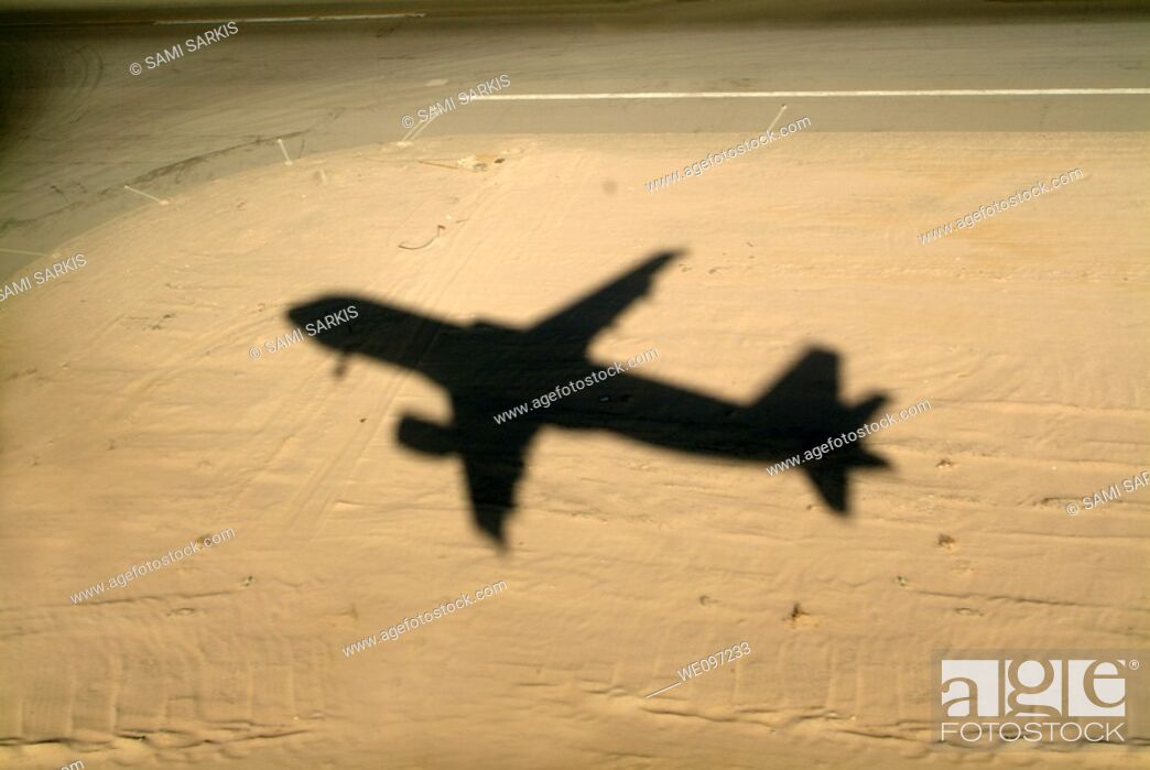 Stock Photo: Shadow of airplane flying into land at Hurghada Airport, Hurghada, Red Sea, Egypt.
