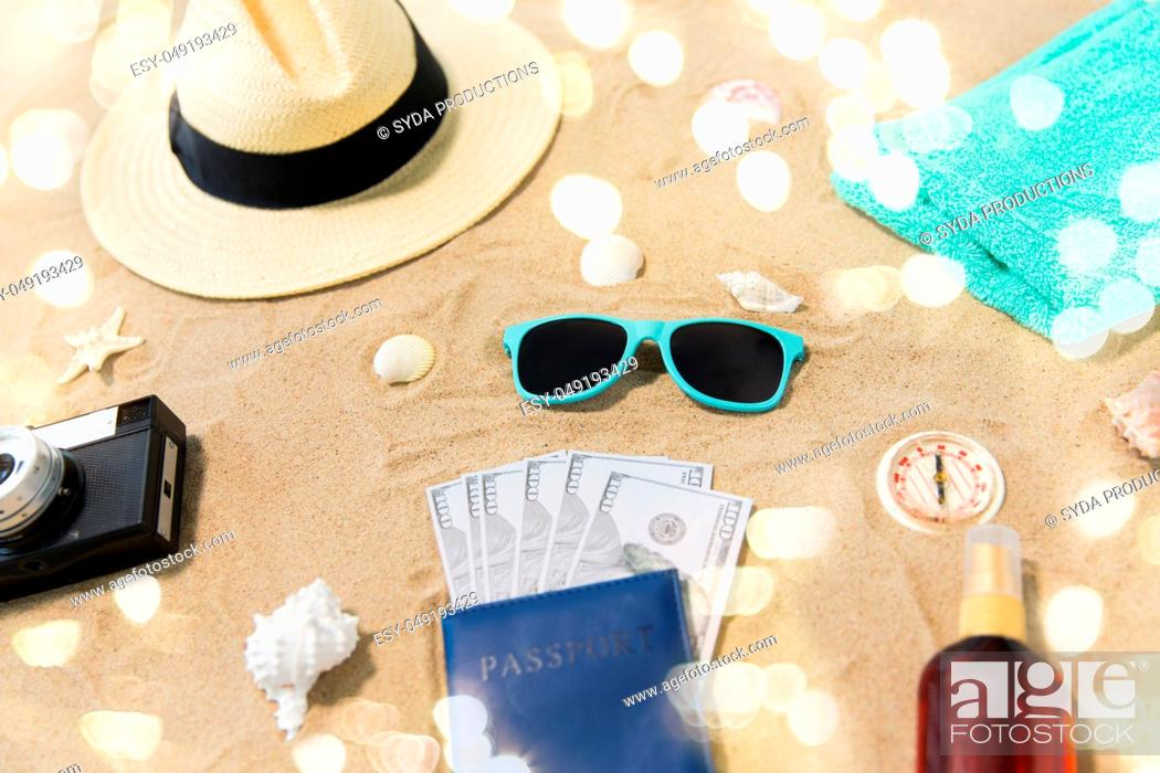 Stock Photo: money in passport, shades and hat on beach sand.