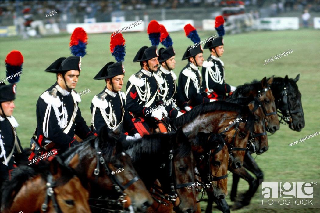 Stock Photo: Militaria, Italy, 20th century. Carousel of the Corps of Carabineers (Arma dei Carabinieri) in Arena Civica of Milan.