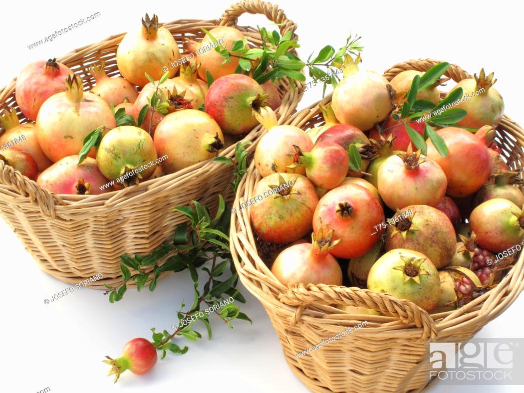 Stock Photo: Pomegranates baskets.