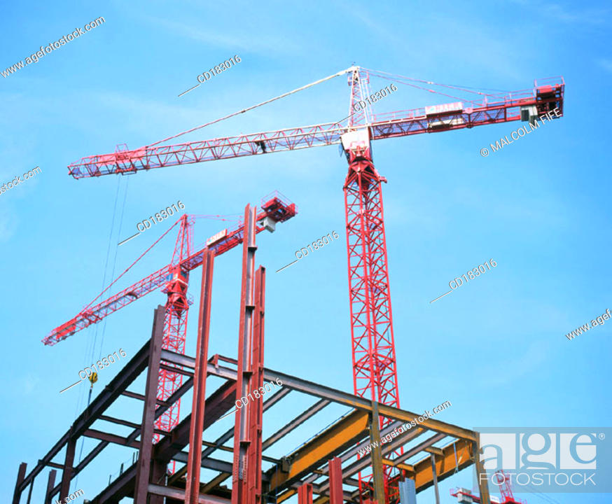 Stock Photo: Construction cranes and office block under construction.