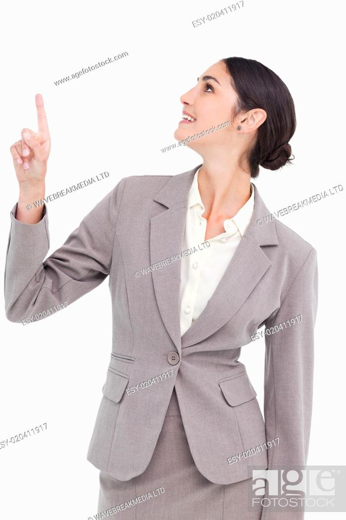 Stock Photo: Smiling businesswoman looking and pointing up.