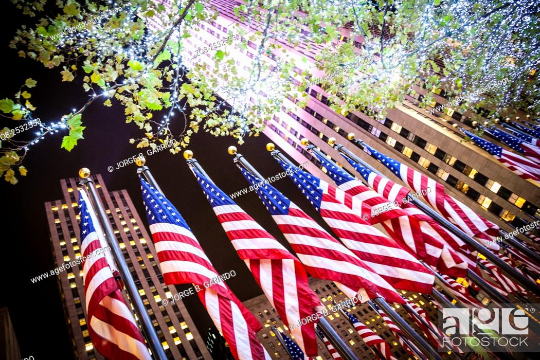 Stock Photo: American flags at the Rockefeller Center.