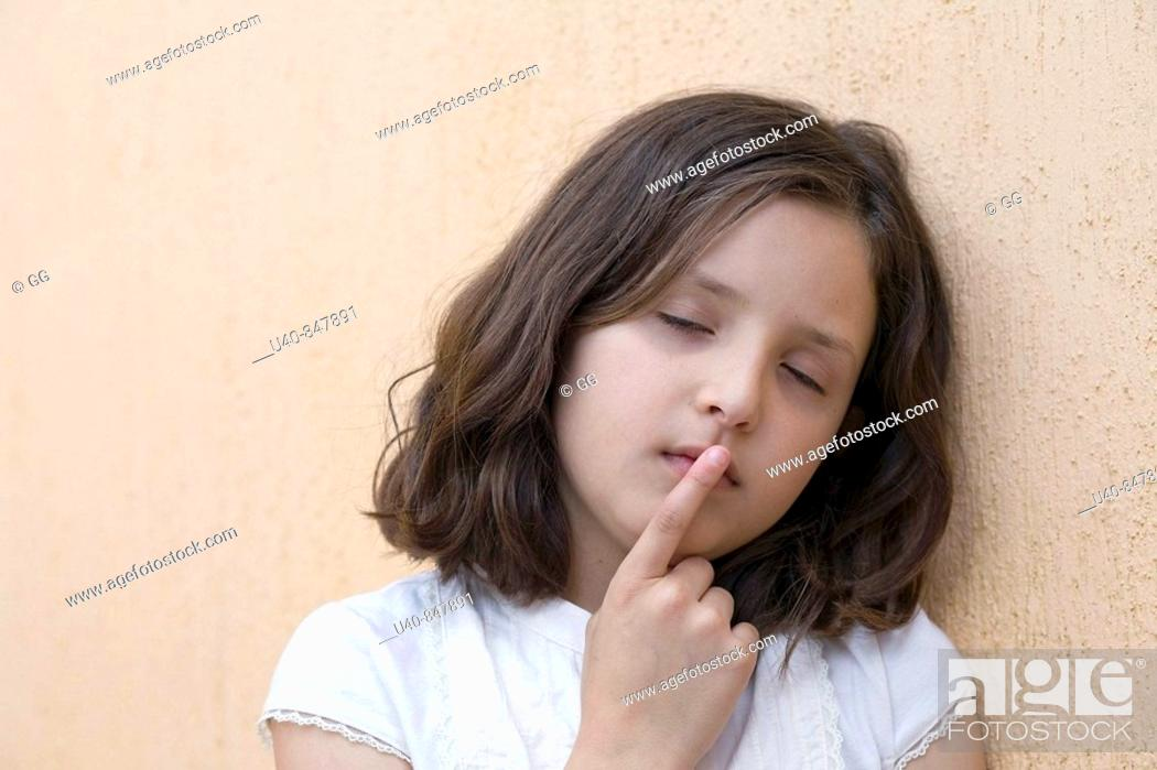 Stock Photo: Girl leaning head against wall.