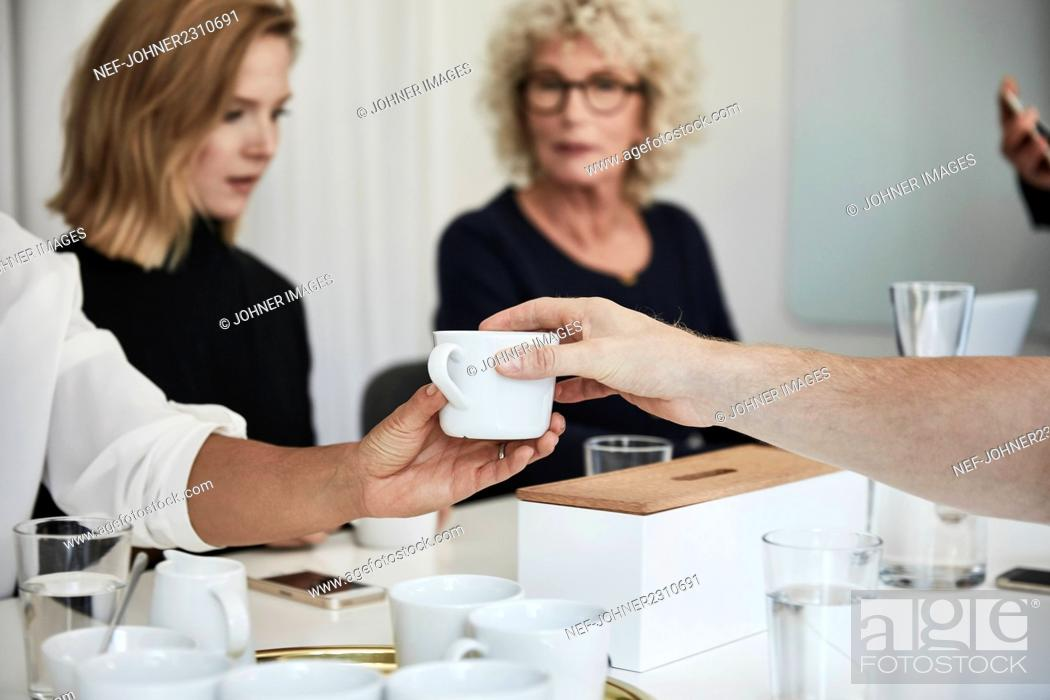 Stock Photo: People holding cup.