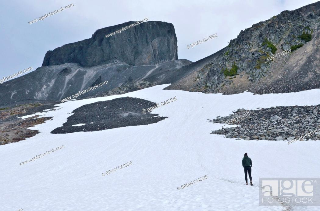 Stock Photo: A hiker on Black Tusk, Garibaldi Park, British Columbia, Canada.