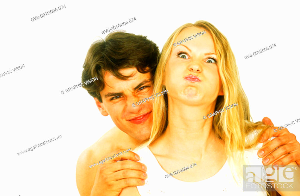 Stock Photo: Portrait of young couple making face.
