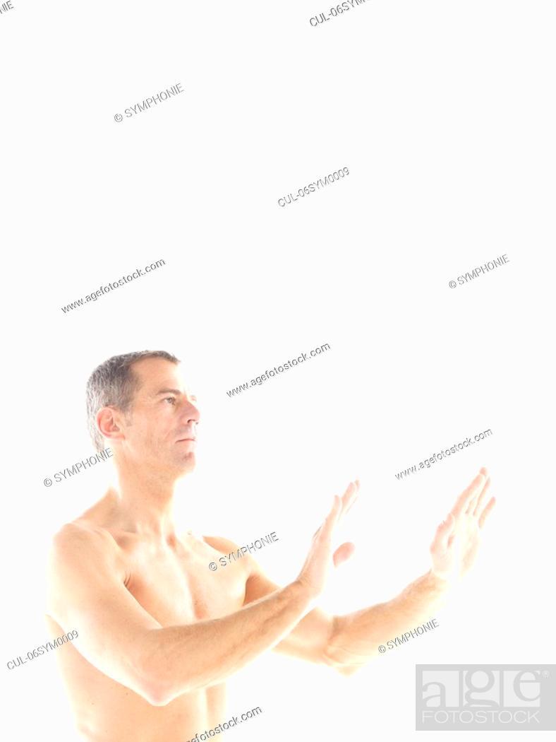Stock Photo: Mature man doing yoga.