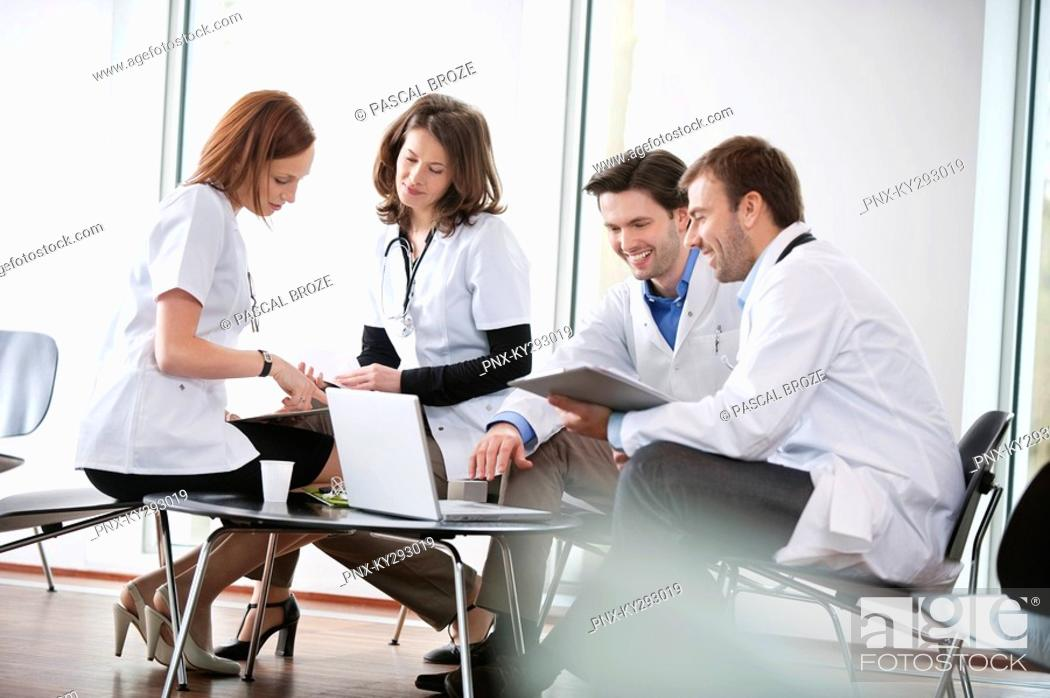 Stock Photo: Doctors discussing together.