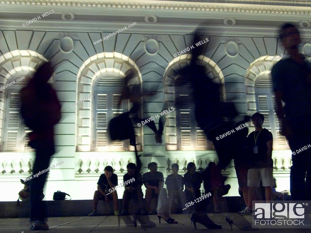 Stock Photo: Singaporeans at Art museum at night.