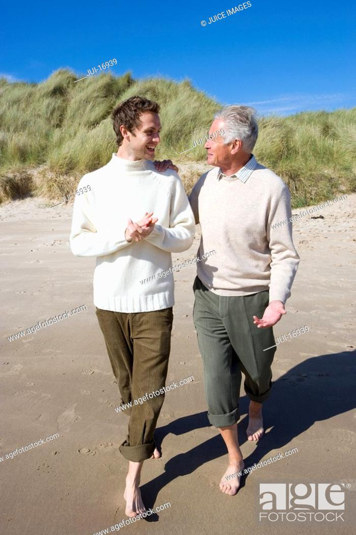 Stock Photo: Two men discussing on beach.