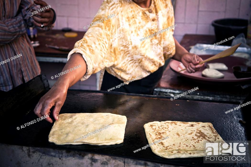Stock Photo: woman making bread, Azilal, Morocco.