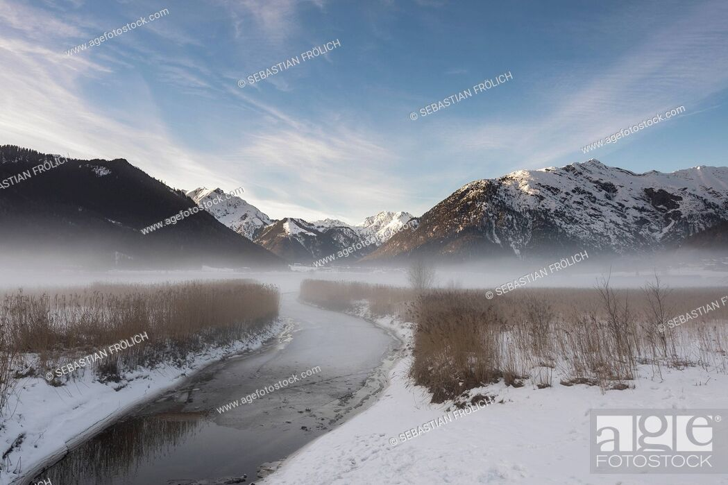 Stock Photo: Misty mood at the creek inlet of the Achensee, Tyrol,.