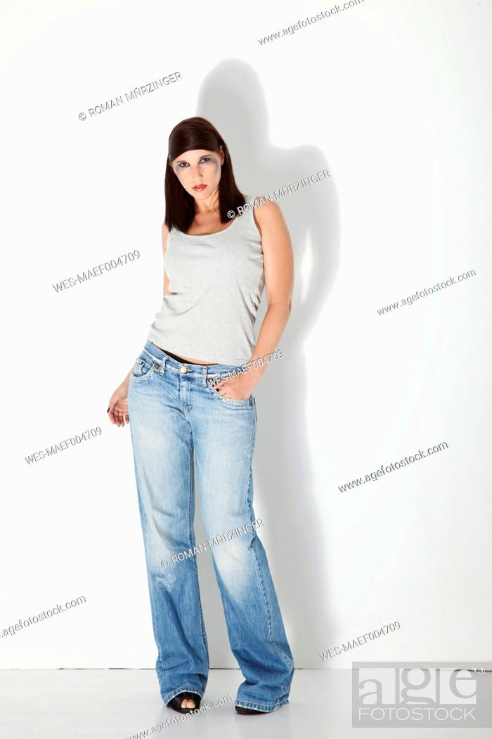 Stock Photo: Portait of young woman against white background.