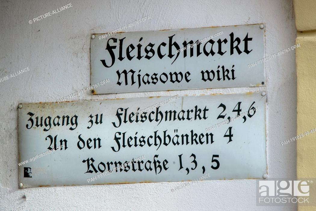Stock Photo: 17 October 2019, Saxony, Bautzen: Historical street and information signs hang on the meat market in the old town. Bautzen, Upper Sorbian Budy·in.