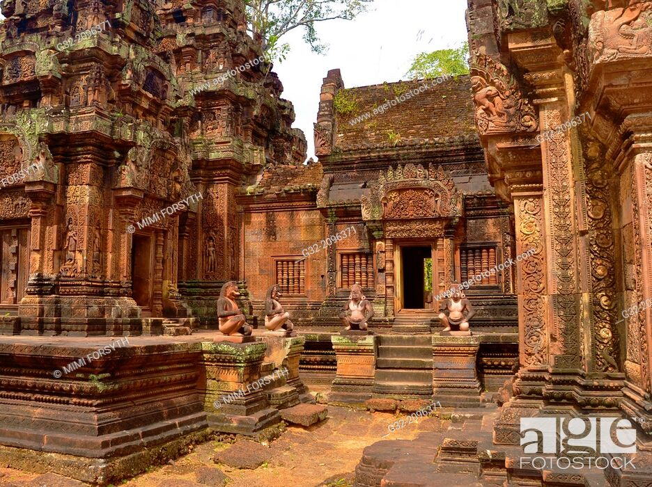 Stock Photo: Banteay Srei temple, cntral courtyard with monkey and yaksha guardian figures. Siem Reap, Cambodia. Dedicated o Hindu god Shiva.