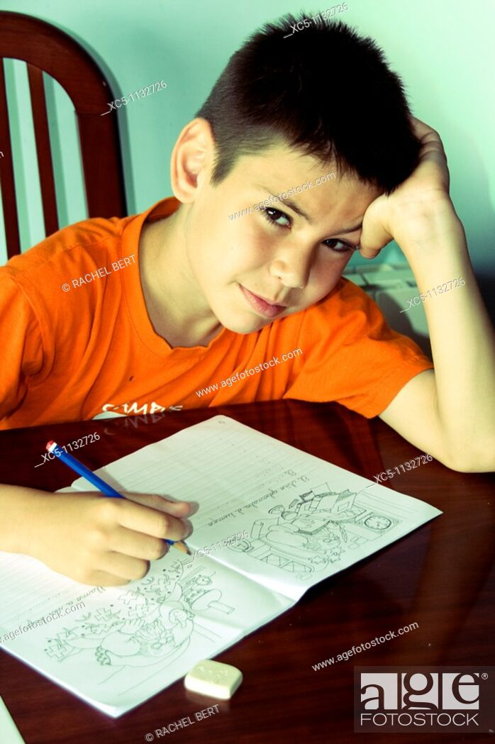 Stock Photo: 9 years old boy doing homework.