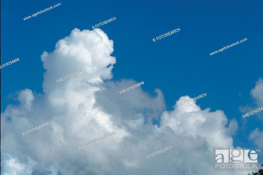 Stock Photo: cumulonimbus clouds, natural world, blue sky, clouds, scenic, blue.