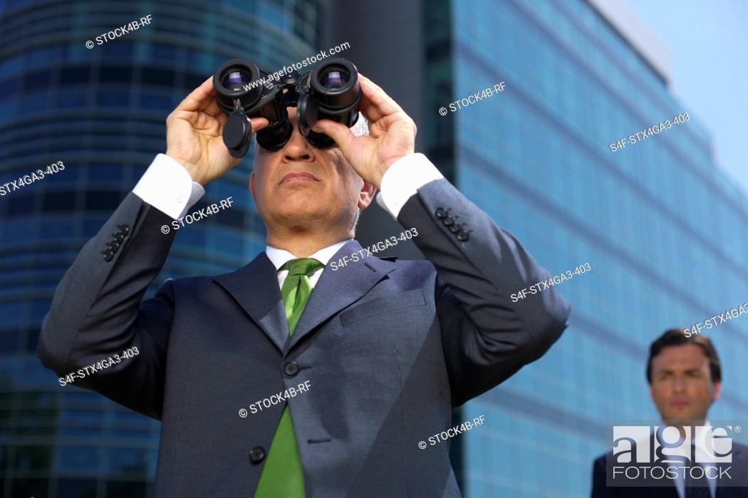 Stock Photo: Businessman with spyglass.