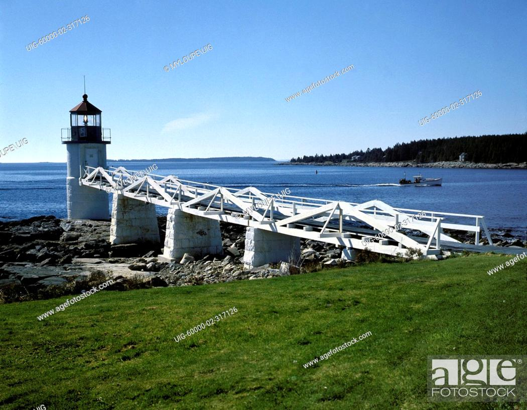 Stock Photo: MARSHALL POINT LIGHTHOUSE 1858 with white plank boardwalk serves the fishing village of PORT CLYDE - MAINE.