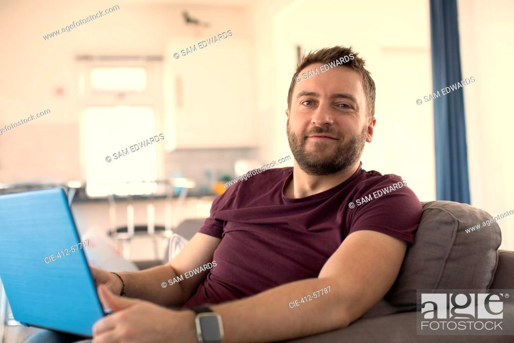 Photo de stock: Portrait confident man working from home at laptop.