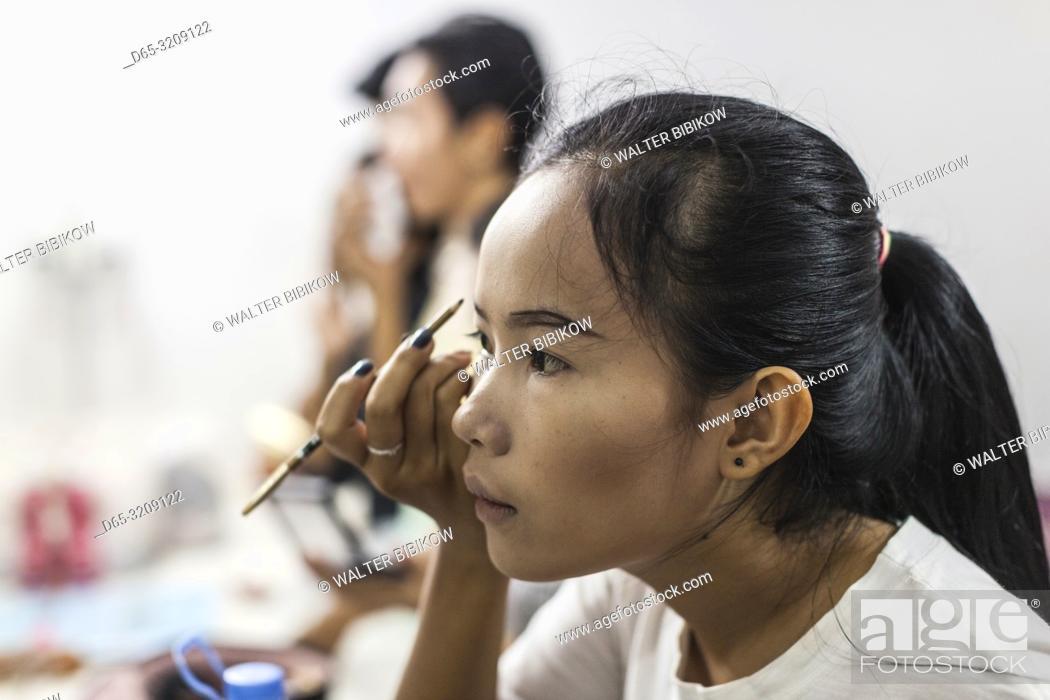 Stock Photo: Cambodia, Battambang, Phar Ponleu Selpak, arts and circus school, young woman performer applying makeup before circus performance, ER.