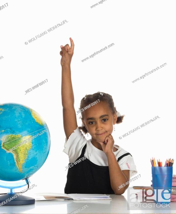 Stock Photo: African girl 6-7 raising hand, portrait.
