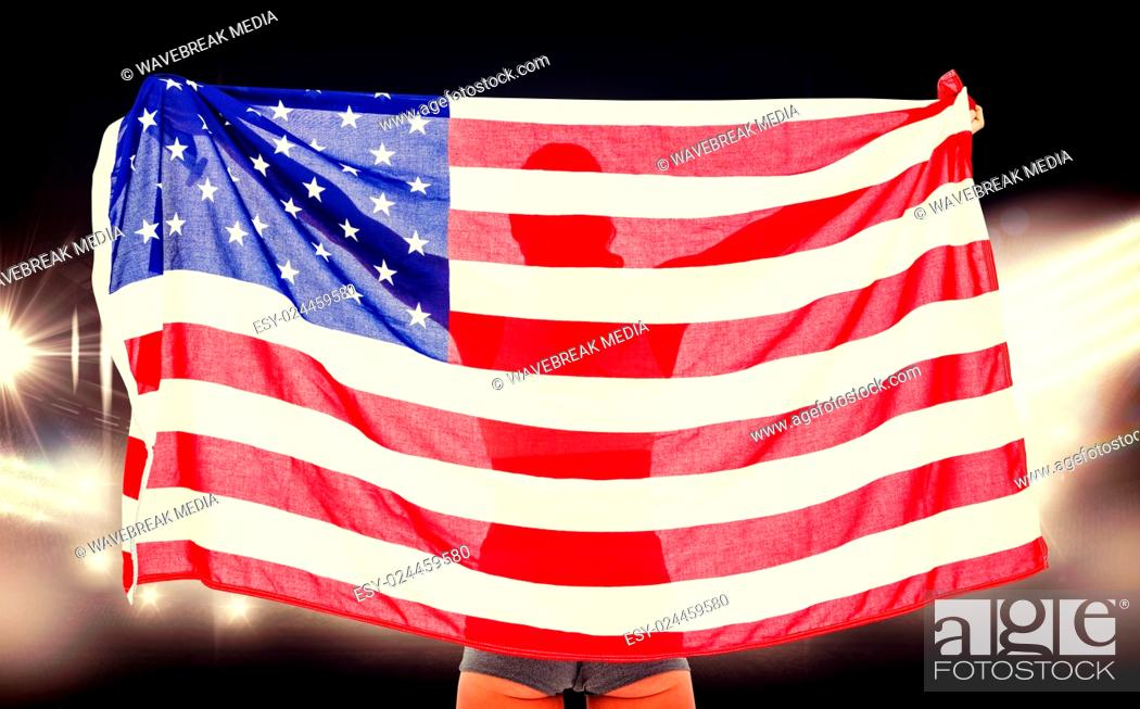 Imagen: Composite image of athlete posing with american flag after victory.