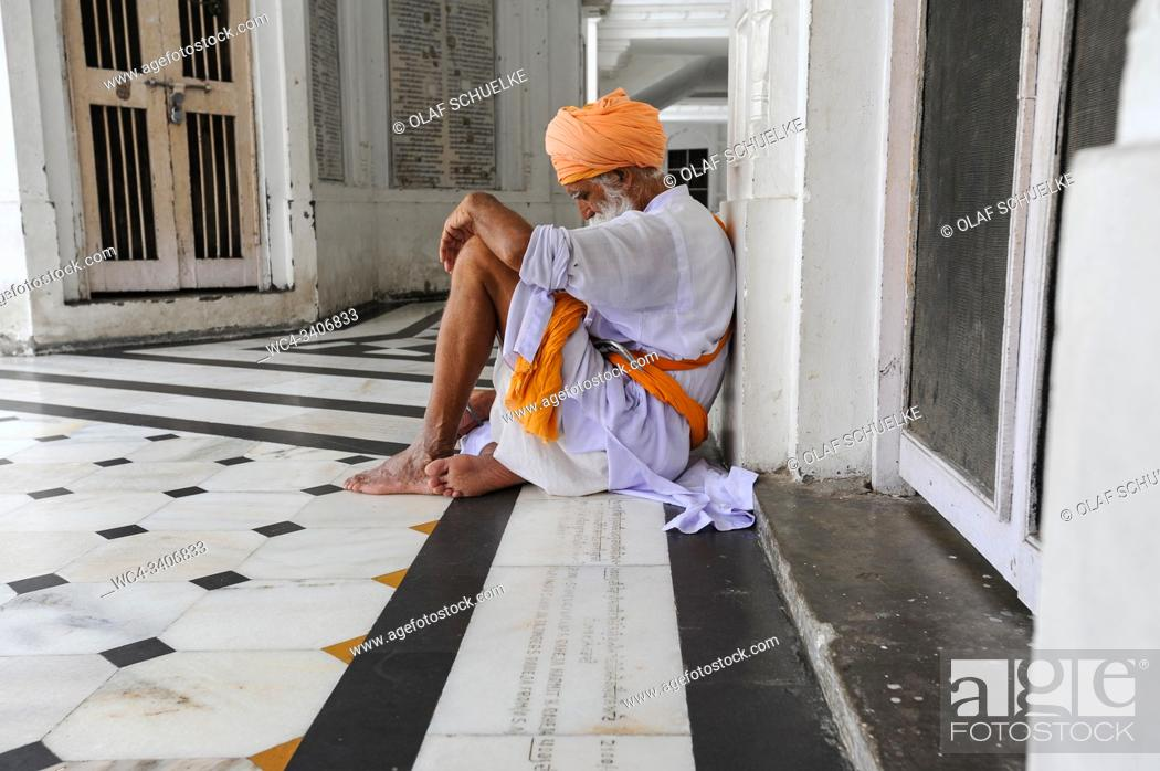 Stock Photo: Amritsar, Punjab, India - Sikh devotee at the Golden Temple sanctuary, the holiest place of worship for Sikhs.