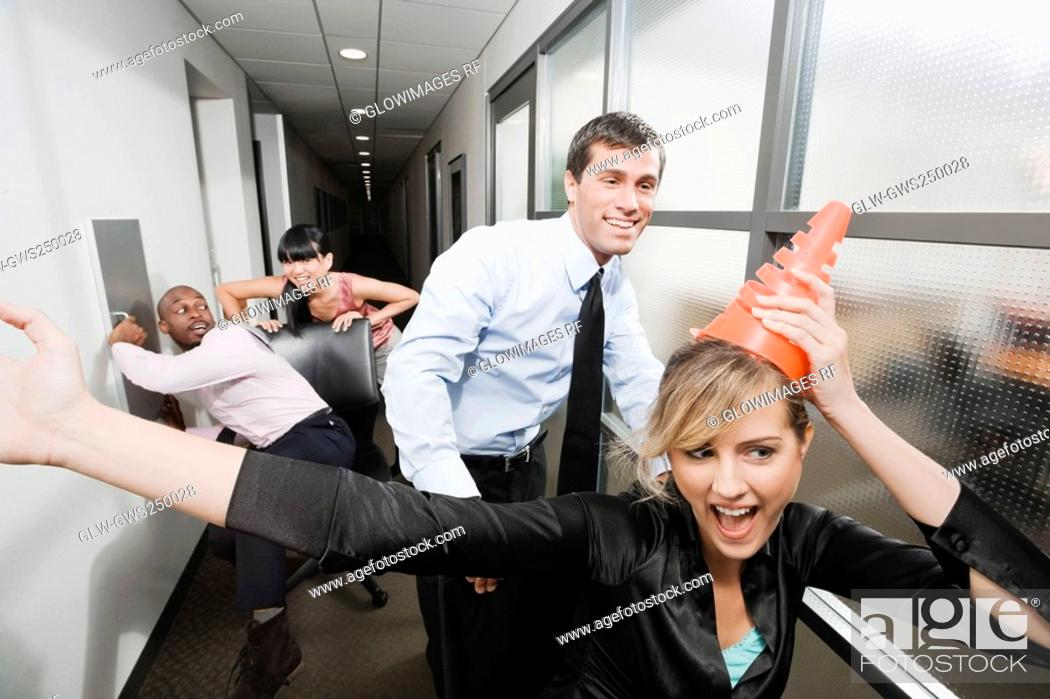 Stock Photo: Office workers playing in an office.