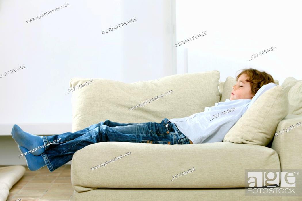 Stock Photo: Boy laying on coach.