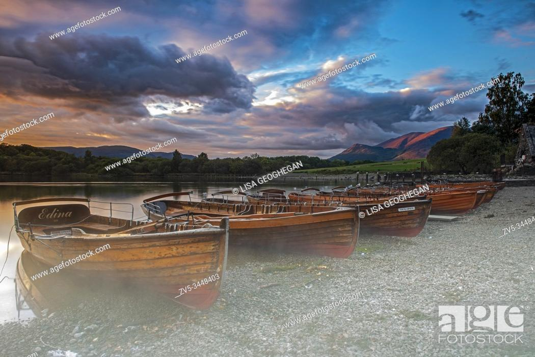 Stock Photo: Rowing boats on the shore of Derwent Water near Keswick at sunset, Lake District, Cumbria, England, Uk, Gb.