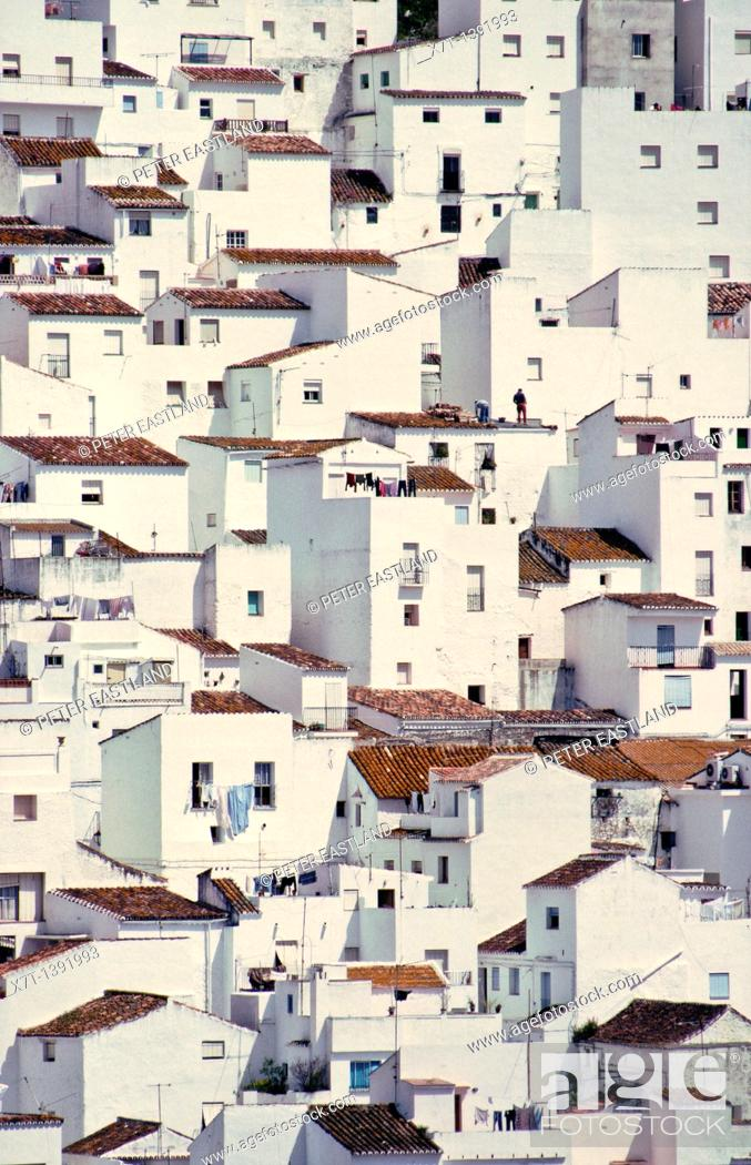 Stock Photo: Houses seem to tumble down a steep hillside as if imitating a cubist painting, in the village of Casares, on the edge of the Sierra de Bermeja near Estepona in.