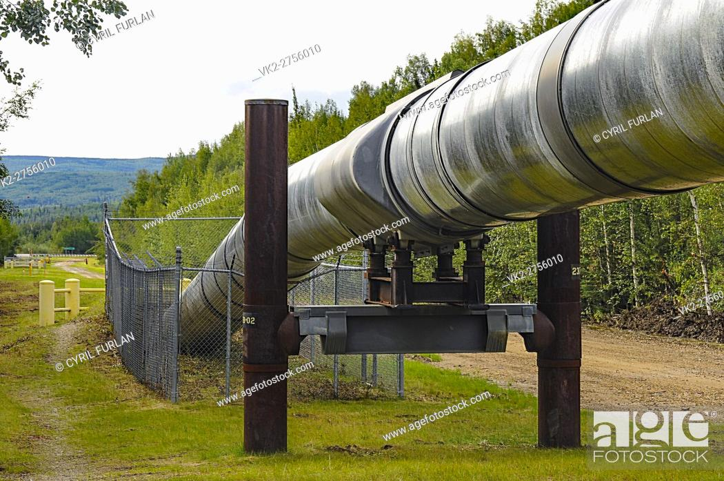 Stock Photo: Above ground and below ground portion of the Alaskan Pipeline, pipe line designed to with stand earthquakes.